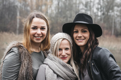 Portrait of three happy friends in autum - HMEF00116