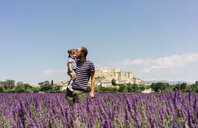 France, Grignan, father kissing his little daughter in lavender field - GEMF02607