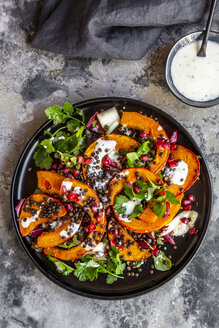 Autumnal salad with fried pumpkin, lentils, radicchio, pomegranate seeds, leaf salad and parsley with dressing - SARF03993