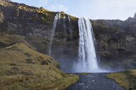 Scenic view of Seljalandsfoss Waterfall over mountain against sky - CAVF56830