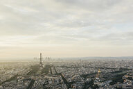 Aerial view of cityscape with Eiffel Tower against cloudy sky - CAVF56974