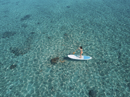 High angle view of woman paddleboarding on sea - CAVF57166