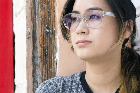 Portrait of young woman wearing fashionable glasses - LMJF00008