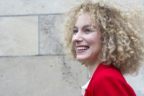 Portrait of laughing blond woman with ringlets - LMJF00047