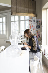 Young designer at work in an atelier - AFVF02045