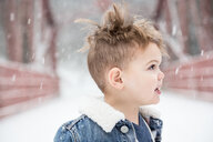Boy With Blond Hair Looking Away During Snowfall - TGBF01623