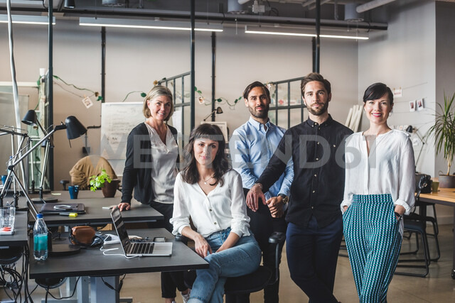 Portrait of confident coworkers by desk in creative office - MASF09974 - Maskot/Westend61