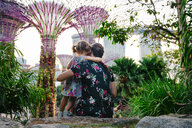 Singapore, Gardens by the Bay, mother and daughter enjoying Supertree Grove at sunset - GEM02641
