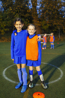 Portrait smiling, confident girl soccer players - HOXF04197