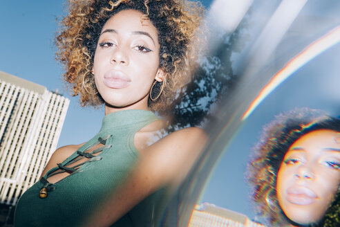Portrait of attractive young woman with reflections in the city - OCMF00161