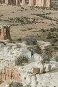 High angle view of carefree hiker hiking at desert - CAVF57595