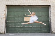 Ballerina dancing by building - CAVF57616