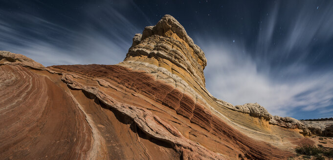 Low angle view of rock formations against cloudy sky at Marble Canyon - CAVF57681