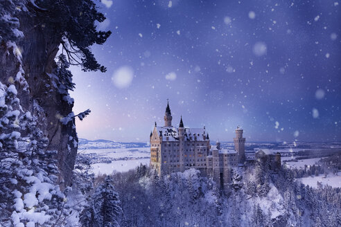 Germany, Hohenschwangau, view to Neuschwanstein castle at snowfall and blue hour - FC01667