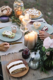 Close-up of couple having a romantic candelight meal outdoors - ALBF00725