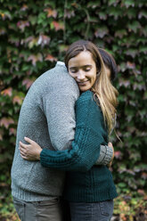 Happy affectionate couple hugging outdoors - ALBF00752