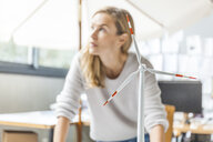 Woman in office working on wind turbine model - TCF06014