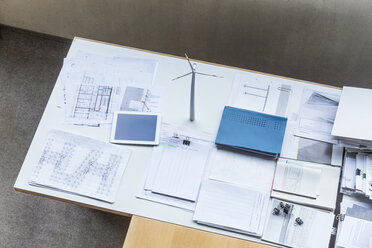 Wind turbine model, construction plans and tablet on table in office - TCF06035