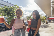 USA, Florida, Miami Beach, two carefree female friends having a soft drink in the city - BOYF01167