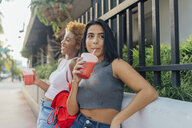USA, Florida, Miami Beach, two female friends having a soft drink in the city - BOYF01179