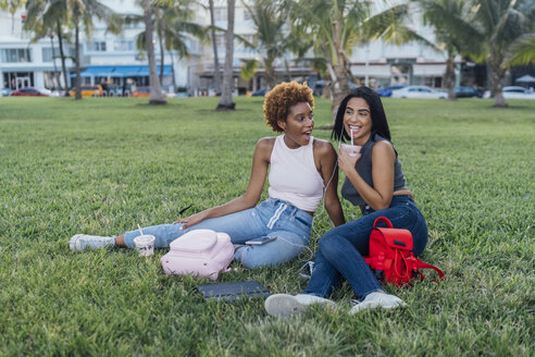 Two happy female friends relaxing in a park - BOYF01188