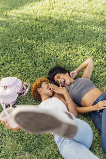 Two carefree female friends relaxing in a park - BOYF01197
