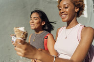 Two happy female friends with ice cream cones outdoors - BOYF01221