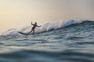 Indonesia, Bali, Batubolong beach, Pregnant woman surfing - KNTF02454