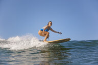 Indonesia, Bali, Batubolong beach, Pregnant woman, surfer in ocean - KNTF02457