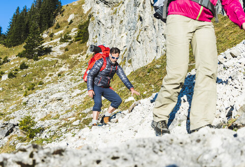 Woman mountain hiking in rocky terrain - UUF15999