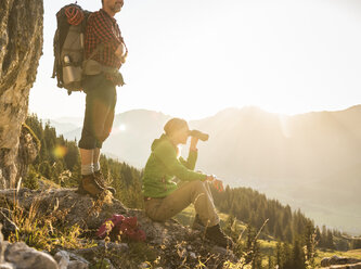 Couple taking a break in the mountains, looking at view - UUF16020