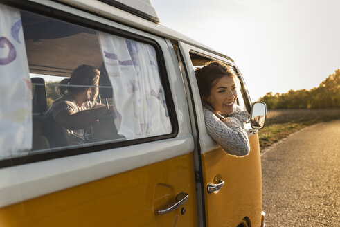 Happy couple doing a road trip in their camper - UUF16227