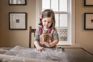 Cute girl making Christmas cookie at home - CAVF58018