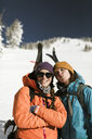 Portrait of friends standing on snow covered mountain against clear sky - CAVF58081