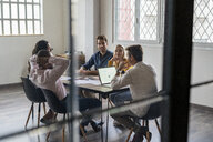 Business team having a meeting in loft office - GIOF04998