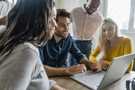 Business team using laptop during a meeting in office - GIOF05022