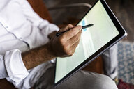 Close-up of businessmen using tablet with digitized pen - GIOF05040