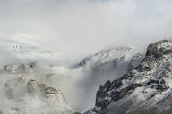 High angle view of snowcapped mountains against cloudy sky during foggy weather - CAVF58647