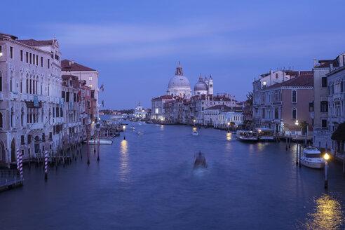 Grand Canal amidst Santa Maria della Salute against sky at dusk - CAVF58704