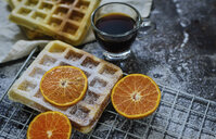 High angle view of waffles with oranges and black coffee on table - CAVF58863