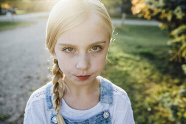 Close-up portrait of girl standing on field - CAVF59115
