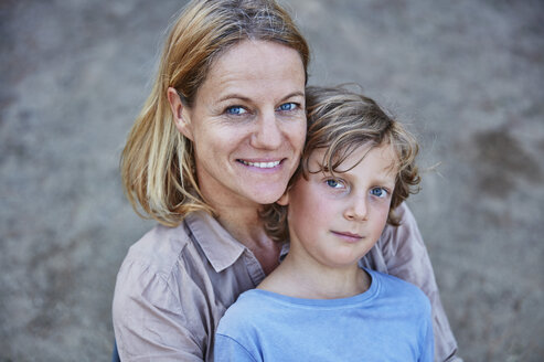 Portrait of smiling mother with son outdoors - SSCF00104