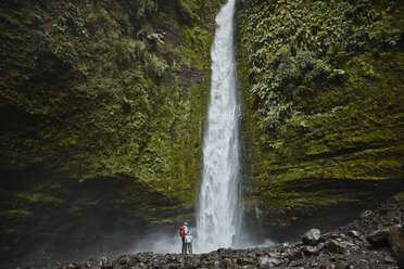 Chile, Patagonia, Osorno Volcano, mother and son standing at Las Cascadas waterfall - SSCF00167