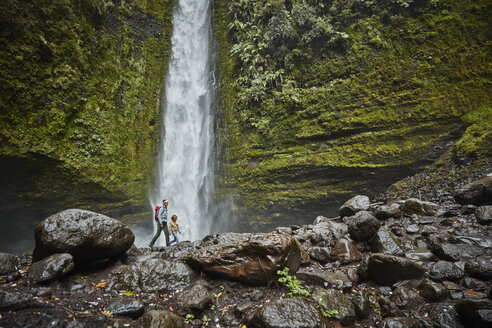 Chile, Patagonia, Osorno Volcano, mother and son walking at Las Cascadas waterfall - SSCF00170