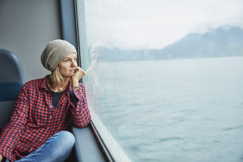 Chile, Hornopiren, woman looking out of window of a ferry - SSCF00197