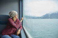 Chile, Hornopiren, woman drawing a heart on the window of a ferry - SSCF00200