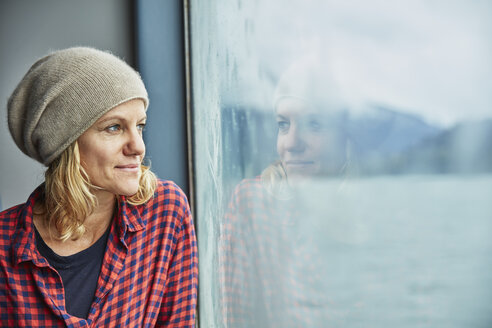 Chile, Hornopiren, portrait of woman looking out of window of a ferry - SSCF00203