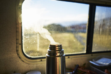 Steaming thermos flask in camper - SSCF00260
