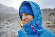 Argentina, Patagonia, El Chalten, portrait of woman in raincoat at Cerro Torre in Los Glaciares National park - SSCF00311