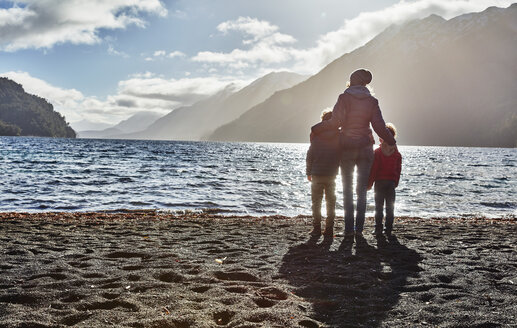 Argentina, Patagonia, Lago Nahuel Huapi, woman with two sons standing at the shore overlooking the lake - SSCF00335